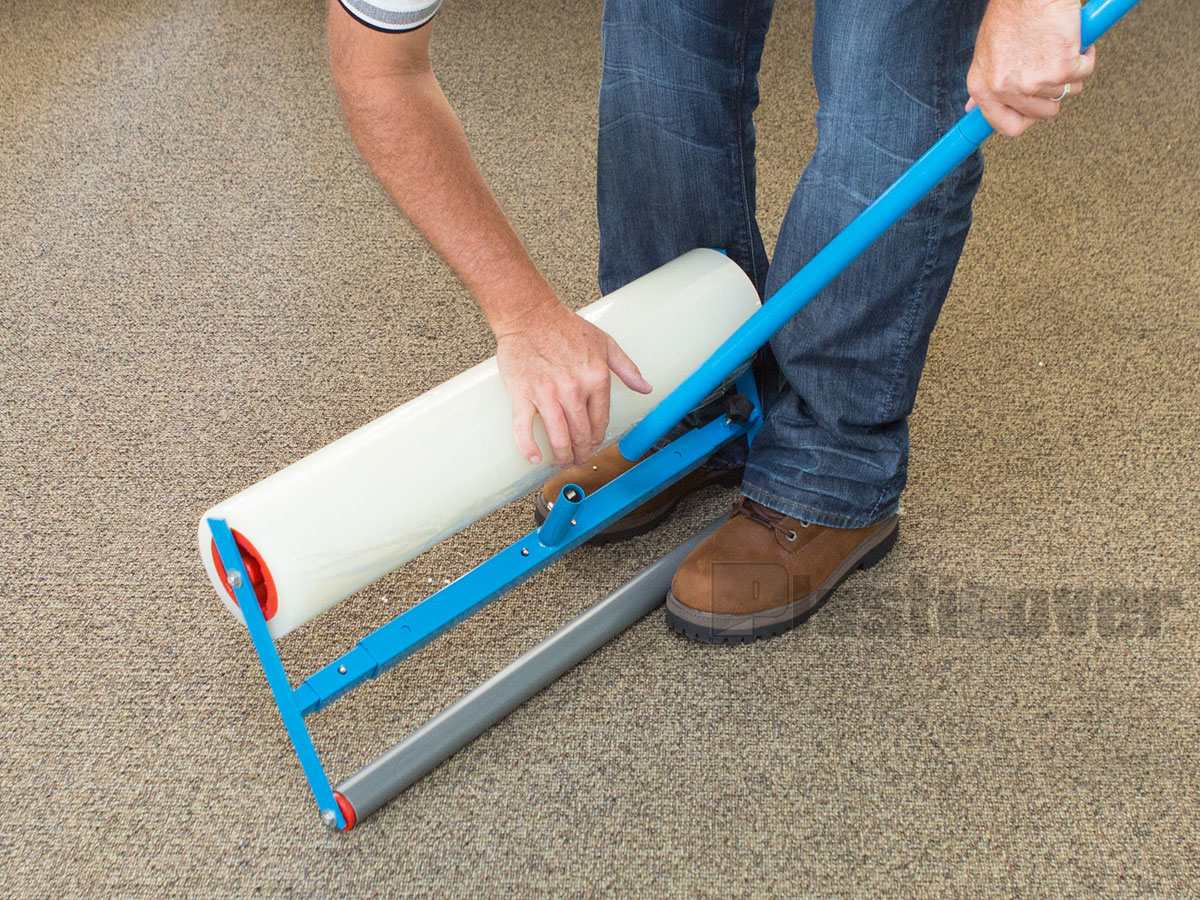 installing handle onto carpet film applicator